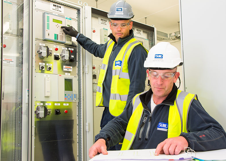 Two Suir engineers' completing final checks
